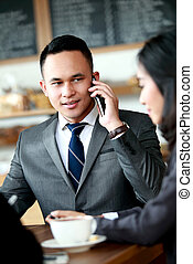 businessman talking on the phone while meeting with partnership
