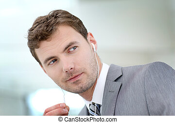Portrait of businessman talking on the phone with handfree headset