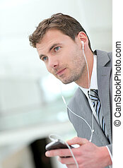 Portrait of businessman talking on the phone with hand free...