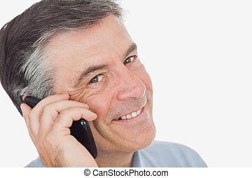 Portrait of businessman using cell phone