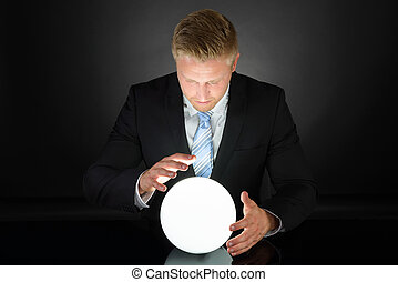 Portrait Of Businessman With Crystal Ball - Portrait Of...