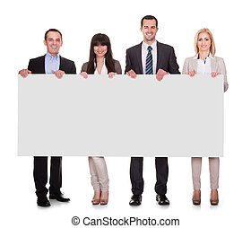 Portrait Of Businesspeople Group Holding Placard