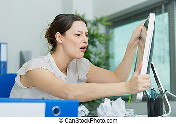 portrait of businesswoman crying at work