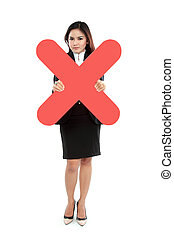 Portrait of businesswoman holding wrong sign