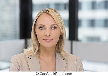 Portrait of businesswoman in modern office. Building in background