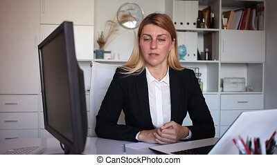 Portrait of businesswoman in protective face mask in business office, new normal business process. High quality FullHD footage