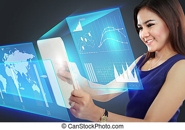 Businesswoman pointing to a graph on transparent touchscreen