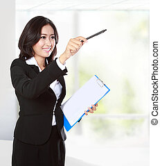 businesswoman pointing to copyspace