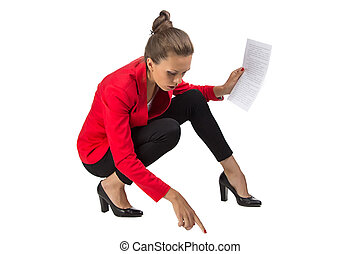 Portrait of businesswoman sitting on floor