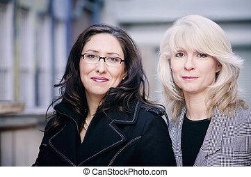 Portrait of fashionable brunette and blonde businesswomen
