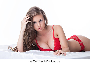 Portrait of busty model posing in red lingerie - Portrait of...