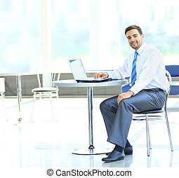 Portrait of busy manager typing on the laptop in the office