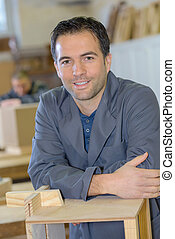 portrait of carpenter man in workshop
