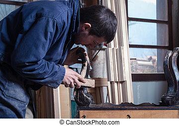 Carpenter restoring Wooden Furniture