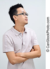 Portrait of casual Asian man looking side