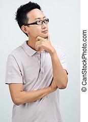 Portrait of casual Asian man thinking