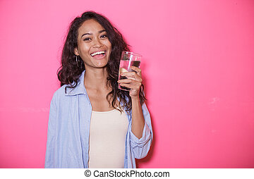 casual asian woman with a glass of mineral water