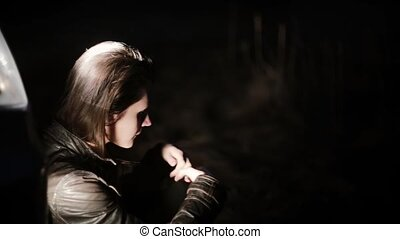 Portrait of Caucasian girl sitting near car lost. Beautiful...