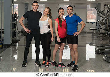 Portrait Of Caucasian Group In Fitness Center Gym