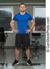 Portrait Of Caucasian Instructor In Fitness Center Gym