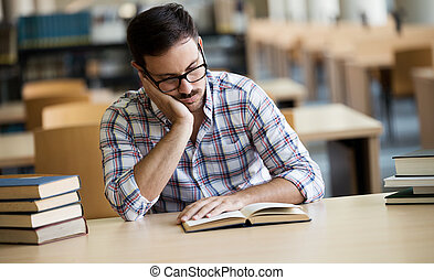 Portrait of caucasian male student sitting at the desk