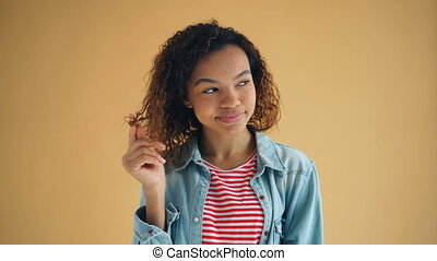 Portrait of charismatic African American lady smiling...
