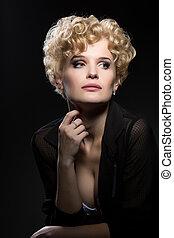 Portrait of charming blonde posing in studio