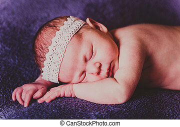 Portrait of charming sleeping baby