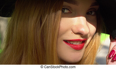 young woman with red lips looking at the camera
