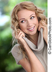 Portrait of cheerful attractive woman
