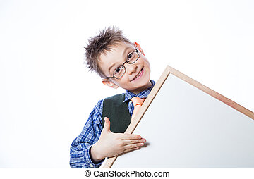Portrait of cheerful boy pointing to banner