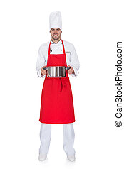 Portrait of cheerful chef holding pot