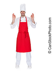 Portrait of cheerful chef in uniform