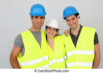 Portrait of cheerful construction team