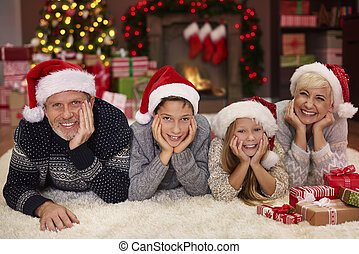 Portrait of cheerful family in the living room