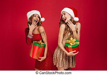 Portrait of cheerful happy women in christmas hats