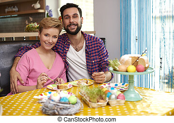 Portrait of cheerful marriage in the kitchen