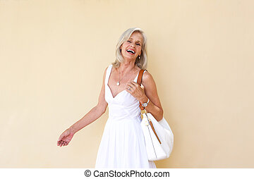 cheerful older woman in summer dress