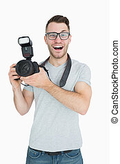 Portrait of cheerful photographer with photographic camera