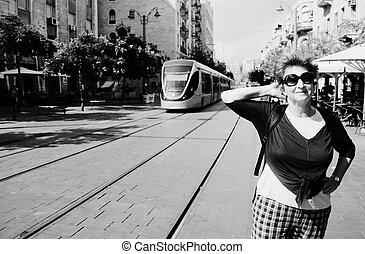 Portrait of cheerful senior woman enjoying the trip