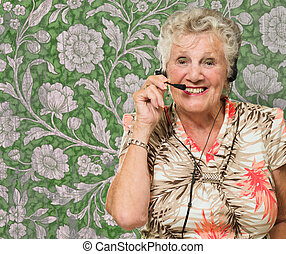 Portrait Of Cheerful Senior Woman With Telephone Headset