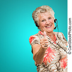Senior Woman With Telephone Headset