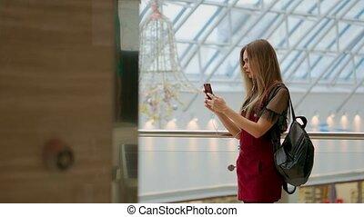 Portrait of cheerful teen girl enjoying music in stereo...