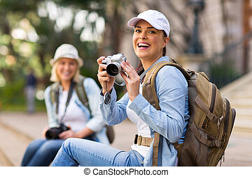 cheerful tourist holding a camera - portrait of cheerful...