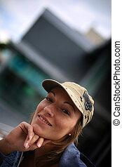 Portrait of cheerful woman in streetwear