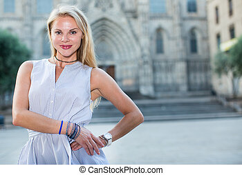 cheerful woman in the dress at the street
