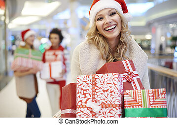 Portrait of cheerful woman with Christmas presents