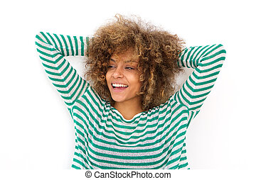cheerful young woman laughing with hands in hair
