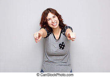 cheerful young woman pointing fingers