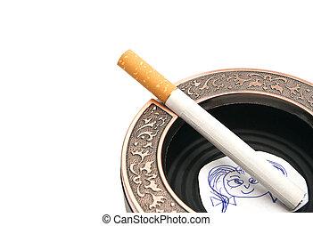 portrait of child and cigarette in ashtray